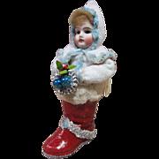 Kestner shoulder head in a Christmas boot