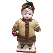"""German All Bisque Winter or Christmas Boy, 7 1/2"""" tall"""