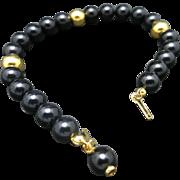 Trifari bracelet black Lucite beads Gold tone
