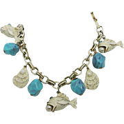 Fish bracelet Gold tone Turquoise plastic beads