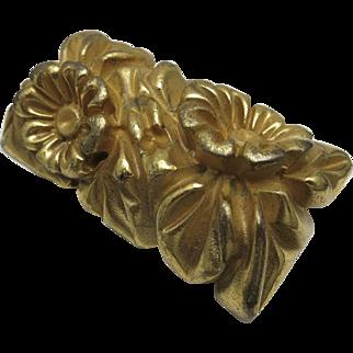 Gilt Bakelite Pin Heavily carved Floral motif