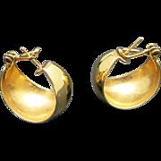 Hoop earrings Gold tone metal Pierced wide Monet