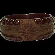 1930's Carved Translucent Cranberry Bakelite Clamper Bracelet