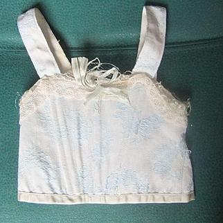 Antique corset doll