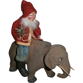 German Santa Claus Riding Nodder Elephant Toy on Wheels