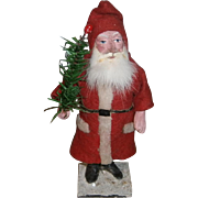 German Santa Claus Candy Container in Long Red Suit Holding a Feather Tree Spray