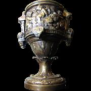 Ornate Cast Bronze Victorian Urn with Playful Putti