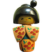 Pretty Kokeshi Doll with Ornate Kimono and Stylized Hair