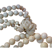 Art Deco Graduated Two Strand Angel Skin Coral Necklace, 30 mm Hand Carved Flower Clasp