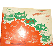 "1956, ""Santa's Song Shop Book"" Very Easy Accordian Music with Words-A Brilliant Collection of World Famous Christmas Carols and Songs; Arranged for the Very Beginner"