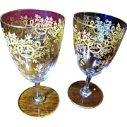 Beautiful Pair of Heavily Decorated Gilt Wine Glasses