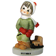 Lefton December Christmas Figurine of Boy Pulling Sled