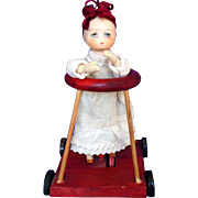 Erzgebrige BISQUE Baby in Walker Pull Toy