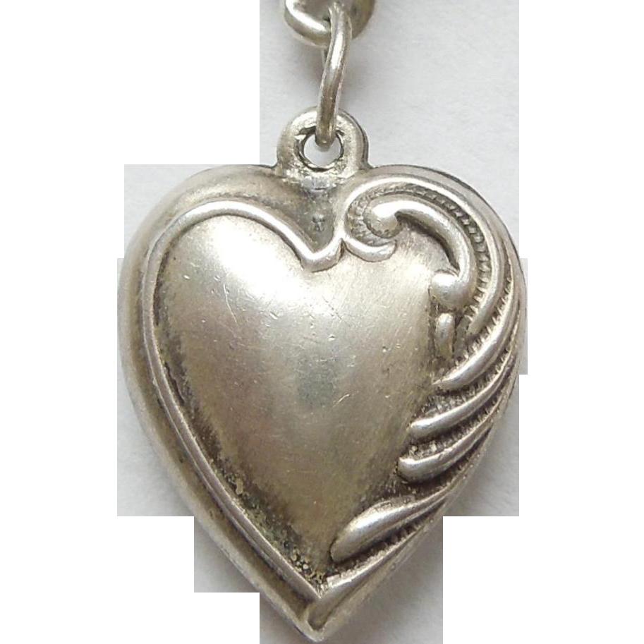 sterling silver charm asymmetrical