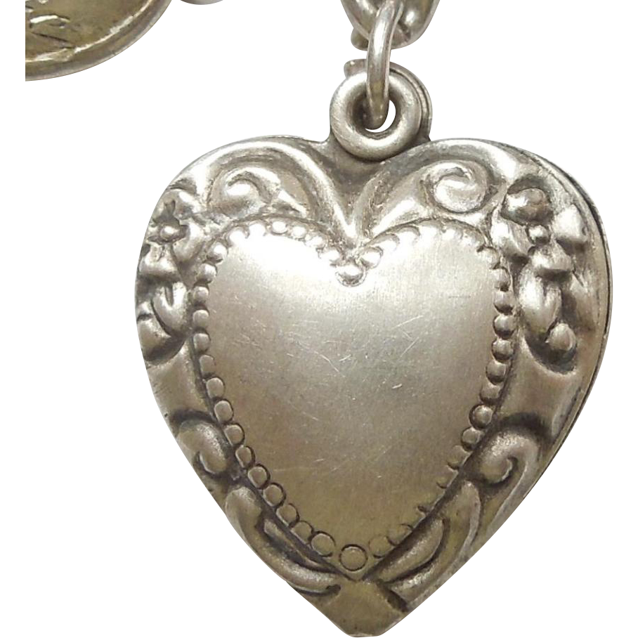 sterling silver charm repousse border