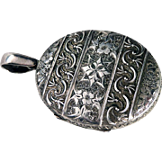 Victorian Repoussé Sterling Silver Floral Scroll Locket