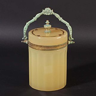 French opaline glass box round with handle Vintage 1920ies. Color: yellow / orange & gold.