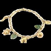 Vintage 14k Yellow Gold Jadeite & Assorated Seven Charms Bracelet