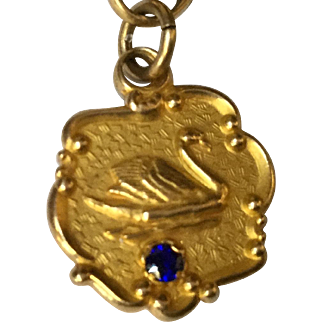 10Kt Yellow gold Charm Swan with Blue Stone