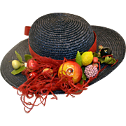 Vintage Blue Straw Doll Hat with Fruit, Feathers, and a Red Ribbon.