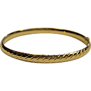Striking Slightly Oval-Hinged Bangle Bracelet in 14K Yellow Gold