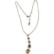 Impressive Graduated Multi Gemstone Necklace with Diamond Accents in 14K White Gold