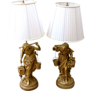 Pair of Mid Century Painted Spelter/White Metal Figural Lamps, signed by Aug Moreau.