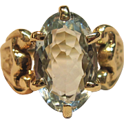 Regal Blue Topaz Ring with Intricate Shoulders in 14K Yellow Gold
