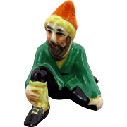 "Vintage Miniature Figurine of Kneeling Man Marked with a Crown & ""Mr"""