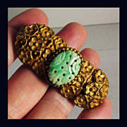 Hand Carved Jadeite Pin with Ornate Gilt Brass Setting