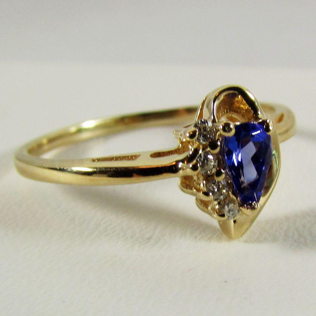 14k yellow gold tanzanite and ring size 8 from
