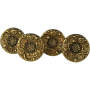Exceptional Set of Four Early 19th Century American Embossed and Figural Gilded Brass Drapery Tie Backs
