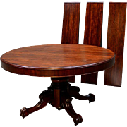 Round 54 inch split base Mahogany dining table