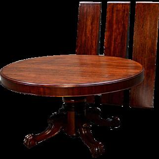Round 54 inch split base Mahogany dining table