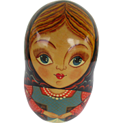 Russian Wooden Doll Makes Music and Tips Back and Forth
