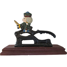 Vintage Nut Cracker Made of Cast Iron on a Wooden Stand