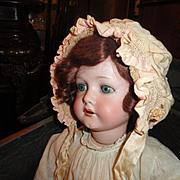 Gorgeous pale peach/pink antique smocked bonnet