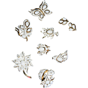 "1967 ""LITTLE WHITE TRIFARI FIGURAL COLLECTION"" White Enamel/White Cabochon Figural Brooch/Pin Collection  BOOK PIECE/AD with Bonus Earrings"