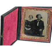 Early Daguerreotype or Ambrotypes Picture of Young Couple in a Case with Brass Colored Bezel under Glass