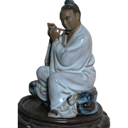Vintage Chinese Figurine on Wood Base Playing Flute