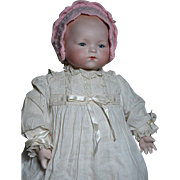 A M 341 Baby Doll  Solid Dome Bisque Head Sleep Eyes  Cloth Body  Nice Gown