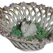 Antique Miniature Porcelain Lattice Basket with a Baby  Rabbit Sitting Inside on Green Grass