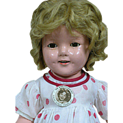 Early Ideal Shirley Temple Composition doll Tagged Dress Also with a  Shirley Temple pin