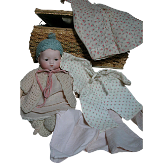 Small A M 341 German Baby Doll in Sewing Basket with Extra Clothes