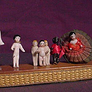 A Group Of Eight Frozen Charlotte Figures