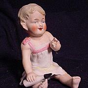 German Bisque Baby Figurine Holding Baby Bottle