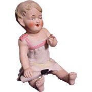 German Bisque Baby Figurine Holding Baby Bottle