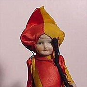 All Bisque Doll Dressed In Unusual Costume