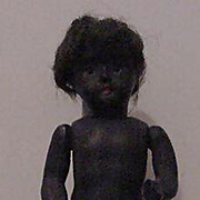 All Bisque Black Child With Swivel Head And Glass Eyes