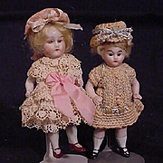 Pair Of German All Bisque With Glass Eyes